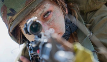 An Israeli female soldier from a mixed-gender battalion takes part in a drill in northern Israel, September 13, 2016.
