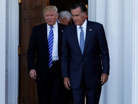 U.S. President-elect Donald Trump (L) and former Massachusetts Governor Mitt Romney emerge after their meeting at the main clubhouse at Trump National Golf Club in Bedminster, New Jersey, U.S., November 19, 2016