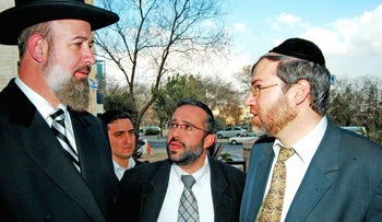 Former Chief Rabbi Yona Metzger (left) and aides, photographed in 2014.