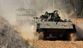FILE PHOTO: An Israeli army tank returns from an attack on a Hamas position in the Gaza Strip, January 15, 2017.