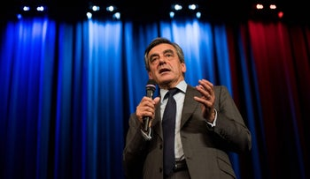 Francois Fillon delivers a speech at a campaign rally in Versailles, France, October 10, 2016.