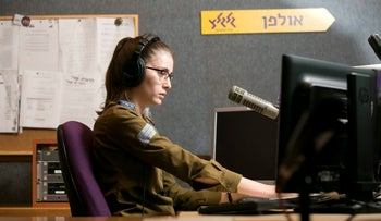 A soldier broadcasts on Army Radio, 2015.