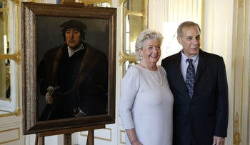 Henrietta Schubert, granddaughter of the late Henry Bromberg poses alongside her cousin Christopher Bromberg in front of the restored painting, in Paris, November 28, 2016.