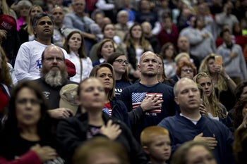 Attendees listen to the National Anthem during a campaign rally for Donald Trump on Friday, Nov. 4, 2016.