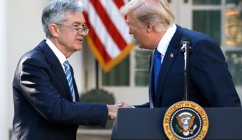 U.S. President Donald Trump arrives shakes hands with Jerome Powell, his nominee to become chairman of the U.S. Federal Reserve at the White House in Washington, U.S., November 2, 2017. REUTERS/Carlos Barria