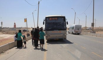 A bus going to Be'er Sheva stops in the Bedouin town of Hura, August 4, 2016.