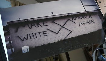 A swastika and a chart showing incidents of post-election hate crimes are shown during a press conference in Washington, D.C., U.S., November 29, 2016.