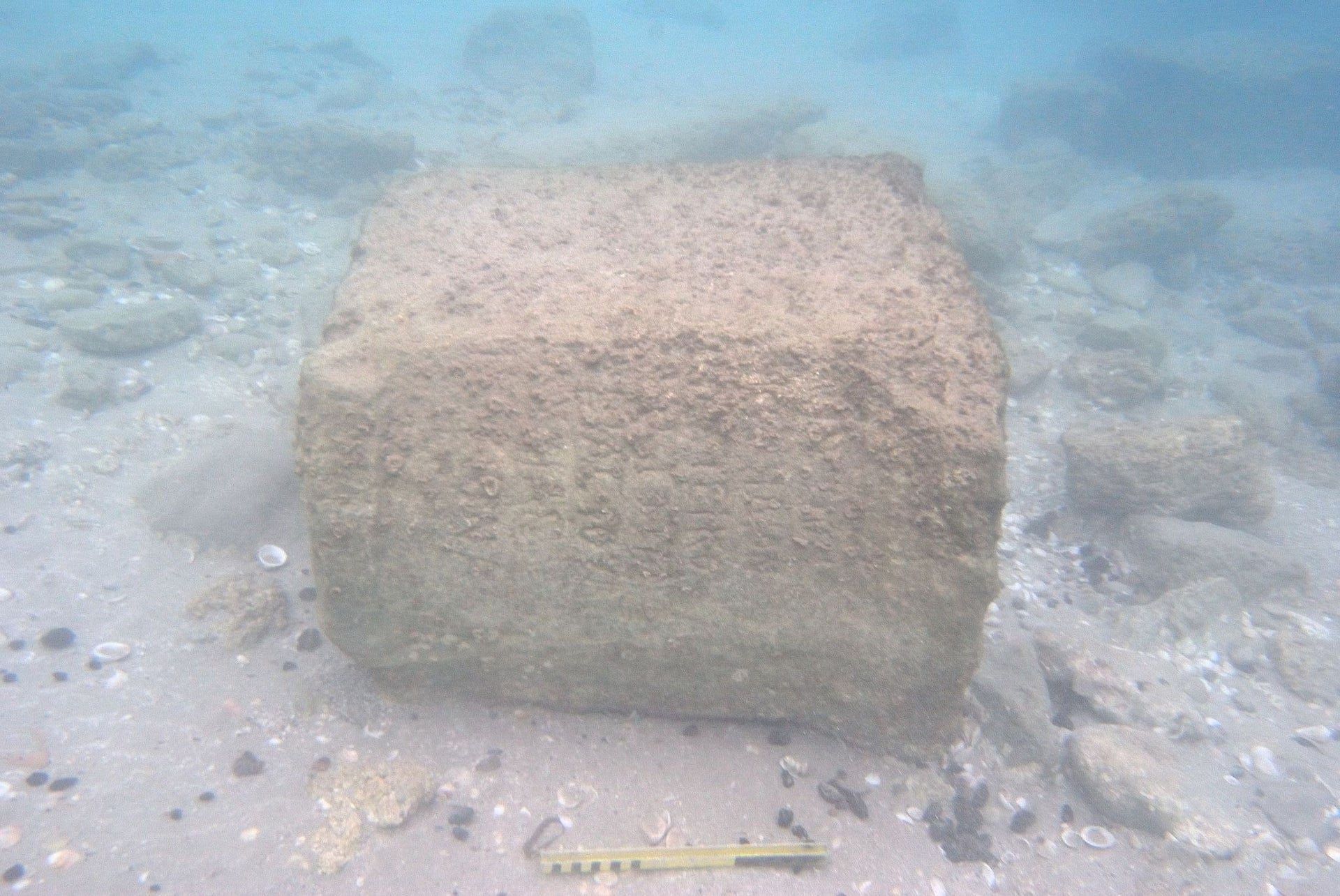 The 1900-year-old Roman inscription mentioning Judea, in situ at a depth of about 1.5 meters on the Dor seabed, after being exposed by a storm.