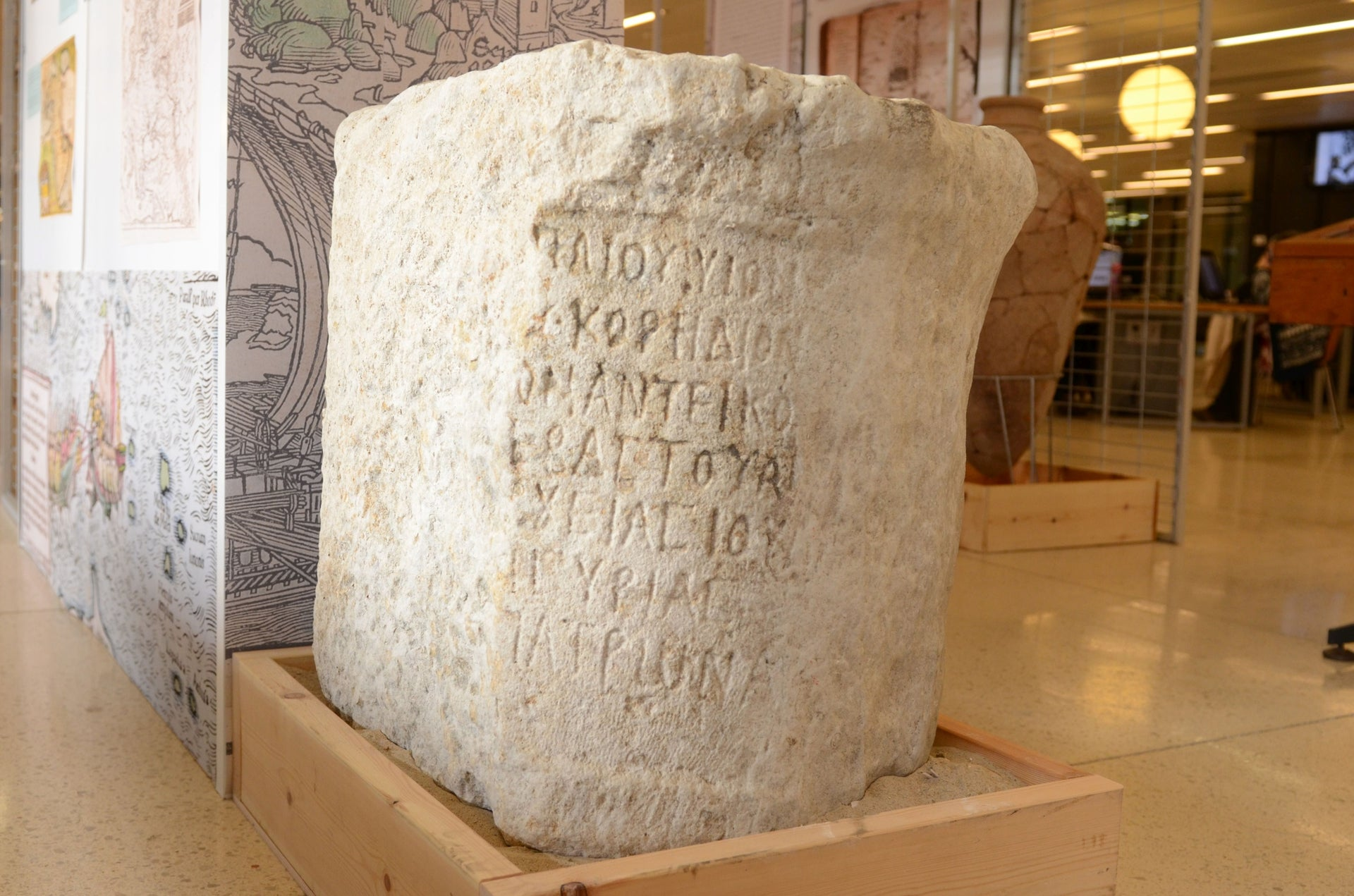 """Cleaned up, the 1900-year-old Roman-era statue base found in the seabed off Tel Dor says: """"The city of Dor honors Marcus Paccius, son of Publius, Silvanus, governor of the province of Judea as well as … of the province of Syria, and a patron of the city of Dor."""""""