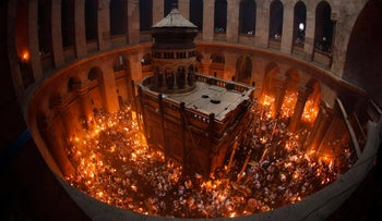 File photo; Worshippers hold candles as they take part in the Christian Orthodox Holy Fire ceremony at the Church of the Holy Sepulchre in Jerusalem's Old city May 4, 2013.