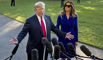 U.S. President Donald Trump speaks to members of the media before boarding Marine One on the South Lawn of the White House in Washington, November 3, 2017.