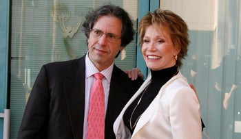 Actress Mary Tyler Moore and husband Dr. Robert Levine pose as they arrive at the Academy of Television Arts & Sciences for a tribute in Los Angeles August 7, 2008.