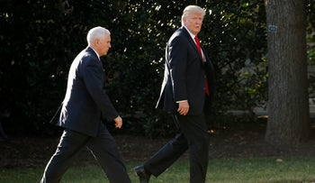 U.S. President Donald Trump (R) and Vice President Mike Pence return to the White House after a visit to Homeland Security headquarters in Washington, U.S., January 25, 2017.