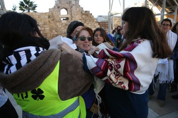 An altercation breaks out during Women of the Wall's monthly prayer service at Jerusalem's Western Wall, December 1, 2016.