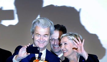 Marine le Pen from France, right, and Dutch populist anti-Islam lawmaker Geert Wilders after their speeches during a meeting of European Nationalists in Koblenz, Germany, Saturday, Jan. 21, 2017.