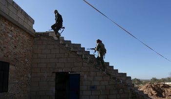 Rebel fighters climb a staircase on the outskirts of Al-Bab town in Syria, January 22, 2017.