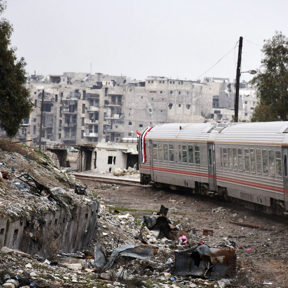 A train travels through Aleppo's devastated eastern districts for the first time in more than four years, on January 25, 2017.