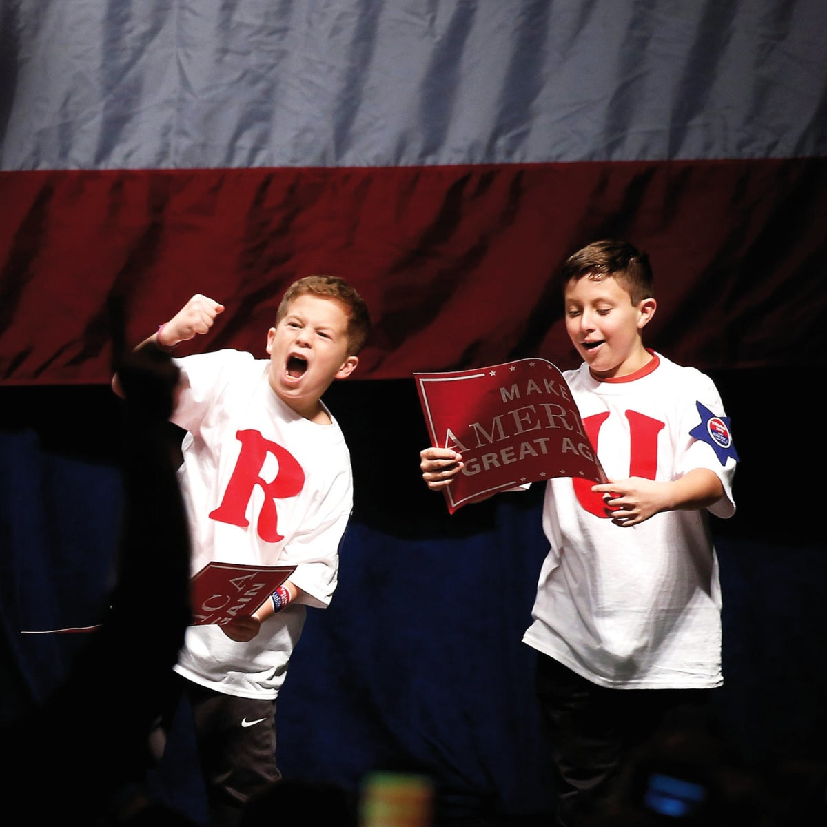 Children react to being called on stage by Donald Trump during a campaign rally in Detroit, Michigan, November 6, 2016.