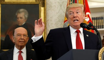 Trump and Commerce Secretary Wilbur Ross at the White House in Washington, U.S., October 24, 2017.