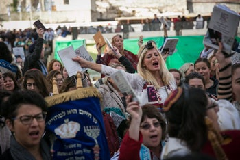 Women pray with Torah scroll at the Western Wall for the first time, November, 2016.