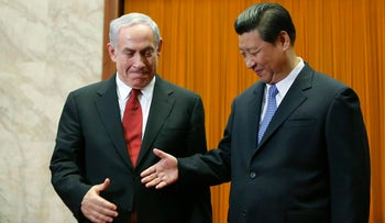 Prime Minister Benjamin Netanyahu shakes hands with Chinese President Xi Jinping at the Great Hall of the People in Beijing.