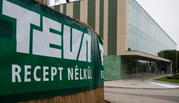 "At Teva's plant in Hungary: Sign white letters on green background, says ""Teva Recept Nelkul"". In the background we see a large glass-fronted green and white building that is part of the Teva complex there."