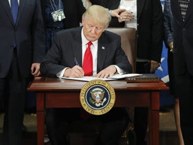 President Donald Trump signs an executive order on border security and immigration enforcement, Washington, January 25, 2017.