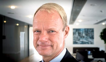 Kåre Schultz, Teva CEO, blond-haired, blue-eyed and with a high forehead, clean-shaven, wearing a sky-blue shirt  and dark tie and suit, pictured in an office.