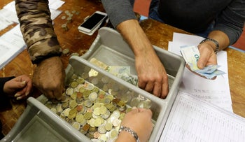 Volunteers count the coins paid by voters who each paid two euros to register their vote in the conservatives' primary contest, Marseille, November 27, 2016.