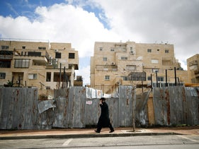 File photo: An ultra-Orthodox Jewish man walks on a road in the Israeli settlement of Beitar Illit in the occupied West Bank.