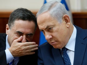FILE - In this Sept. 26, 2017 file photo, Israeli Prime Minister Benjamin Netanyahu listens to transportation minister Yisrael Katz during the weekly cabinet meeting at his office in Jerusalem. (Gali Tibbon, Pool via AP, File)