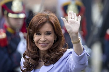 Argentina's President Cristina Fernandez waves as she arrives for the 47th Mercosur Summit in Parana, Argentina, Dec. 17, 2014.