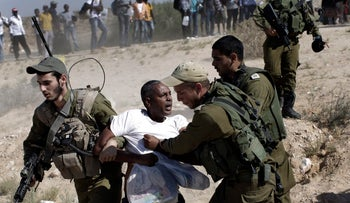 FILE PHOTO: African migrants clash with Israeli soldiers after they left Holot detention center in southern Israel and walked towards the Border with Egypt near the southern Israeli Kibbutz of Nitzana, Friday, June, 27, 2014.