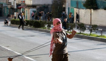 A Palestinian protester using a slingshot to hurl stones toward Israeli security forces, February 2016.