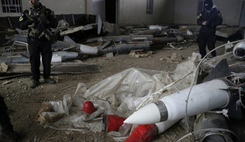 Iraq's special forces troops inspect missiles found in a warehouse in the eastern side of Mosul, Iraq, Saturday, Jan. 28, 2017.