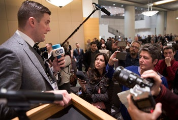 Richard Spencer, left, talks to the media at an alt-right conference hosted by the National Policy Institute in Washington, November 18, 2016.