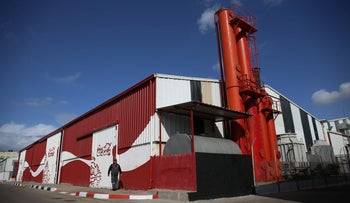 A picture shows the new Coca-Cola bottling facility in the industrial area east of Gaza City on December 1, 2016.