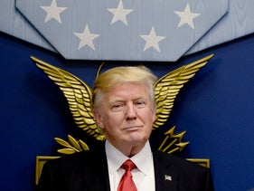 U.S. President Donald Trump stands before signing executive orders in the Hall of Heroes at the Department of Defense in Arlington, Virginia, U.S. on Friday, Jan. 27, 2017.