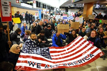 Demonstrators protest against Donald Trump's executive order aimed at refugees and Muslim travelers at Seattle-Tacoma International Airport, January 28, 2017.