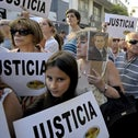 Citizens protest against the death of public prosecutor Alberto Nisman in front of the headquarters of the AMIA in Buenos Aires, Argentina, January 21, 2015.