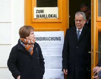 Austrian presidential candidate Alexander Van der Bellen, who is supported by the Greens, and his wife Doris Schmidauer leave polling station in Vienna, Austria, December 4, 2016.