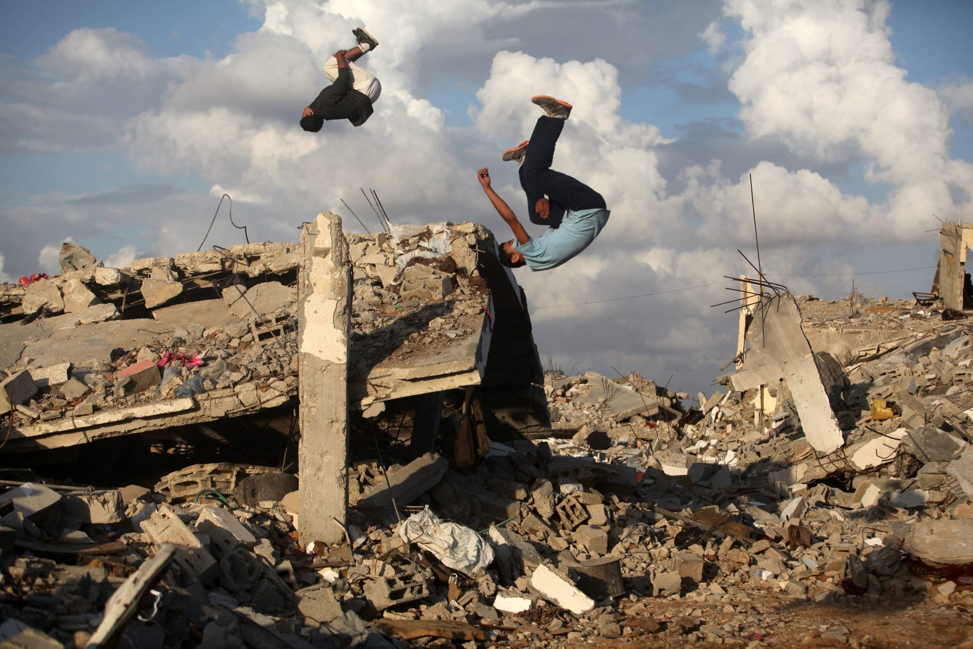 Palestinian youths practice their Parkour skills over the ruins of houses, which witnesses said were destroyed during a seven-week Israeli offensive, in Khan Younis city in Gaza Strip, 2014.