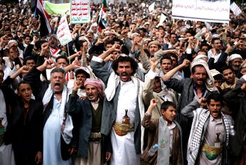 Houthi Shi'ite rebels chant slogans during a protest near the site of a suicide bombing in Sanaa, Yemen, October 9, 2014.