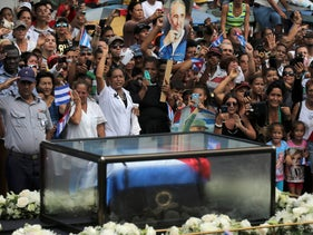 People line a road to watch as the caravan carrying Cuba's late President Fidel Castro's ashes passes through Las Tunas, Cuba, December 2, 2016.