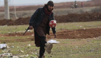 A rebel fighter plays with a ball in al-Rai town, northern Aleppo countryside, Syria January 20, 2017