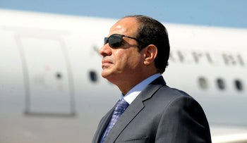In this June 25, 2014, file photo, Egyptian President Abdel-Fattah el-Sissi stands at Algiers airport on his arrival to Algiers, Algeria