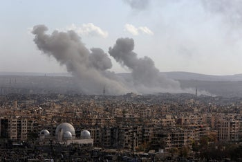 Smoke rises after airstrikes in Aleppo, Syria, December 3, 2016.
