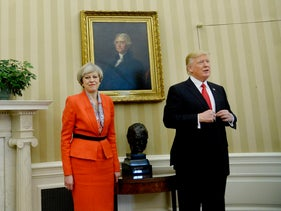U.S. President Donald Trump, right, stands for a photograph with Theresa May, U.K. prime minister, in the Oval Office of the White House in Washington, D.C., U.S., on Friday, Jan. 27, 2017.