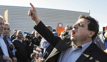 The head of Israel's Arab parliamentary bloc, Ayman Odeh (R), leads a demonstration by Arab Israelis against house demolitions carried out by Israeli authorities in Arab neighbourhoods, in front of the Knesset (Israeli parliament) in Jerusalem on January 23, 2017.
