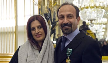 Iranian film director Asghar Farhadi, and his wife Parisa in February 2014 after he was awarded the Officer of the Order of Arts and Letters medal in Paris.